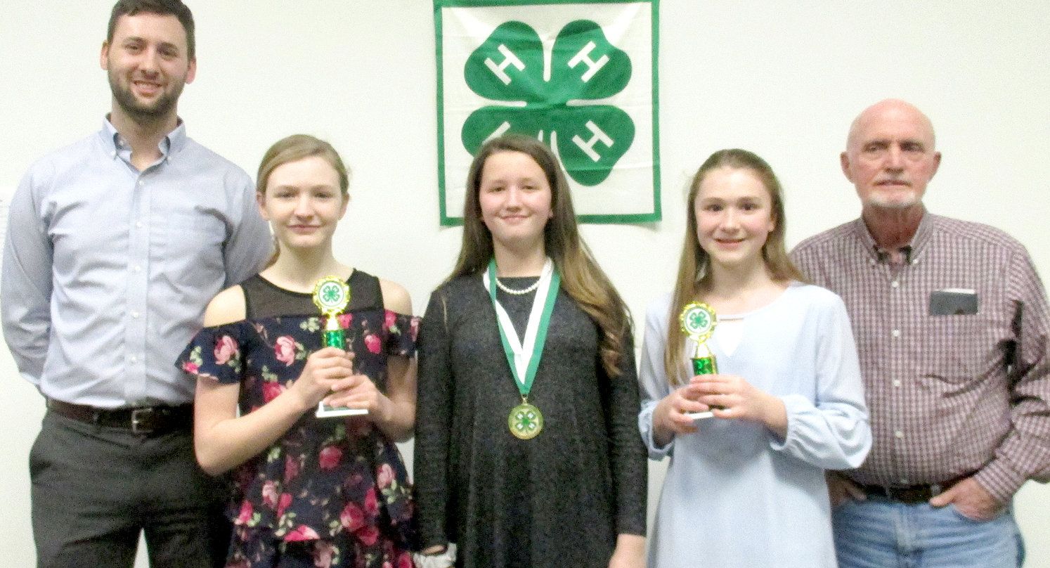 The Bradley County 4-H Public Speaking sixth-grade winners were, from left, Madison McNabb, second place (Lake Forest Middle School), Mary Lowry, first place (Ocoee Middle School), and Sadie Wiefaert, third place (Ocoee Middle School) with judges Mike Stoess and Charles Bagley, members of the Kiwanis Club of Cleveland. First-place winners will advance to the Southeastern Corner Speech Contest March 14 in Rhea County.