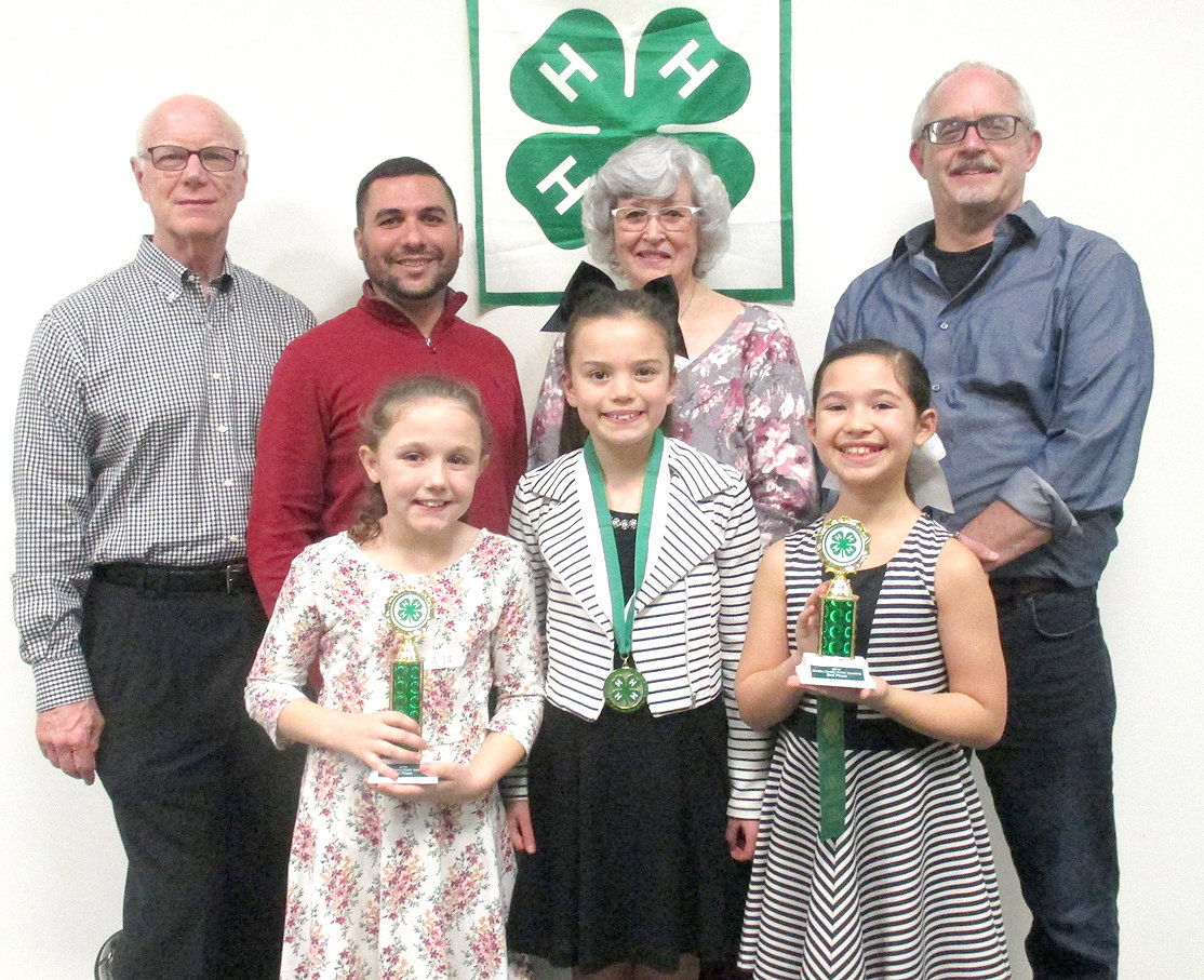 The Bradley County 4-H Public Speaking Contest is sponsored by the Kiwanis Club of Cleveland.  This year, nearly 2,000 youth participated in the Public Speaking Contest. The Bradley County 4-H Public Speaking fourth-grade winners were, from left front, Kiley Johnson (Prospect School), second place; Lilly Winters (Black Fox School), first place; and Kadence Guyton (Hopewell School), third place with judges (back) Rodney Fitzgerald, Jake Duos, Barbara Peterson and Richard Hughes, all members of the Kiwanis Club of Cleveland. First-place winners will advance to the Southeastern Corner Speech Contest March 14 in Rhea County.