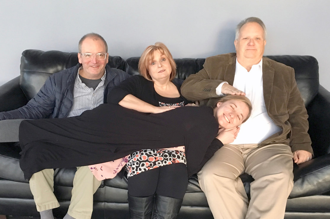 """Sylvia,"" played by Kasey Torbett, finds a resting place on the laps of fellow cast members Trevis Orr, Susan Guentensberger, and Jeff Guentensberger."