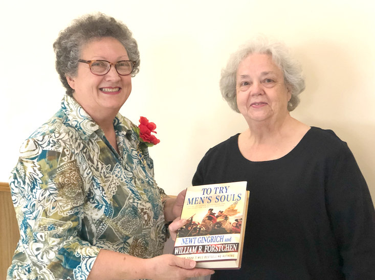 "Sue Geren Diehl presents the book ""To Try Men's Souls"" to Regent Anita Green  for the Chestuee DAR chapter's library."