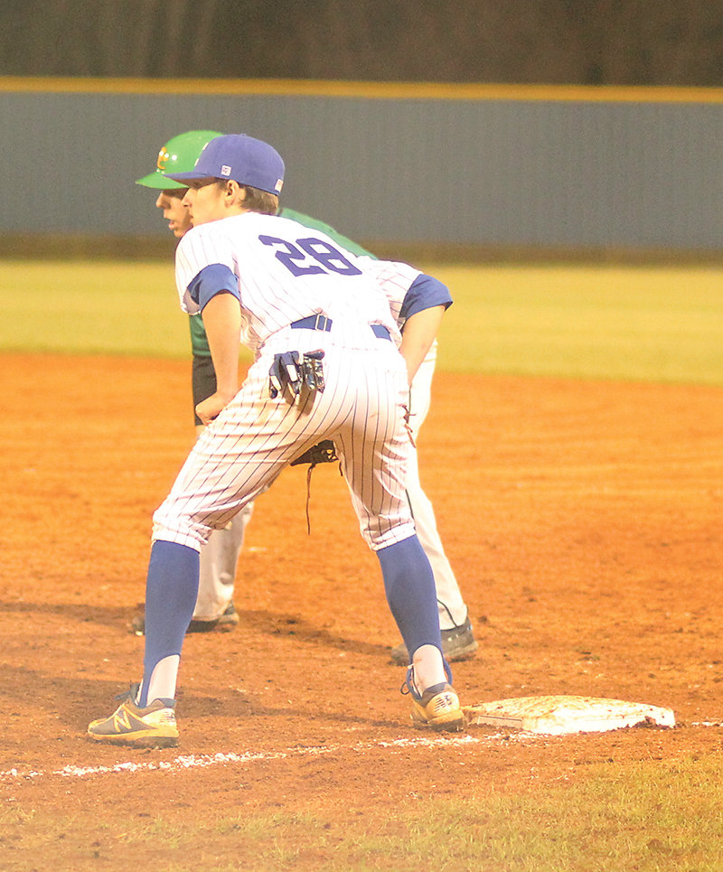 CLEVELAND HIGH first baseman Hunter LeVert (28) holds on a Rhea County runner during Tuesday evening's season opener at Raider Field.