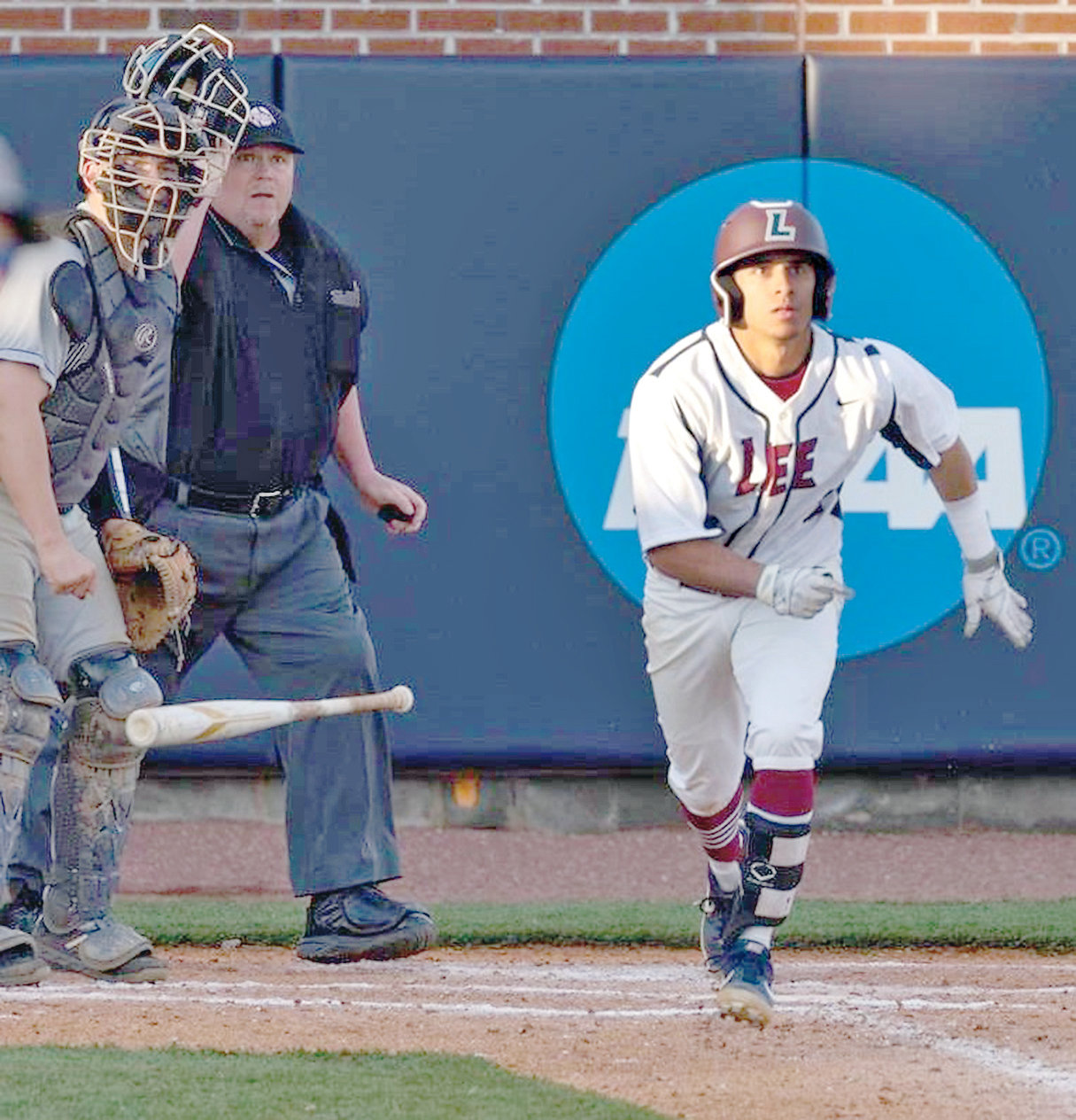 LEE UNIVERSITY senior Fernando Ortiz watches a base hit to right in Wednesday's nightcap as the Flames were swept by Young Harris at Olympic Field.