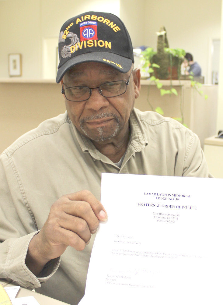 FRATERNAL ORDER OF POLICE member Wayne Jarrett, a former Charleston police chief, displays a letter from the local FOP chapter noting that he's both a current and active member.