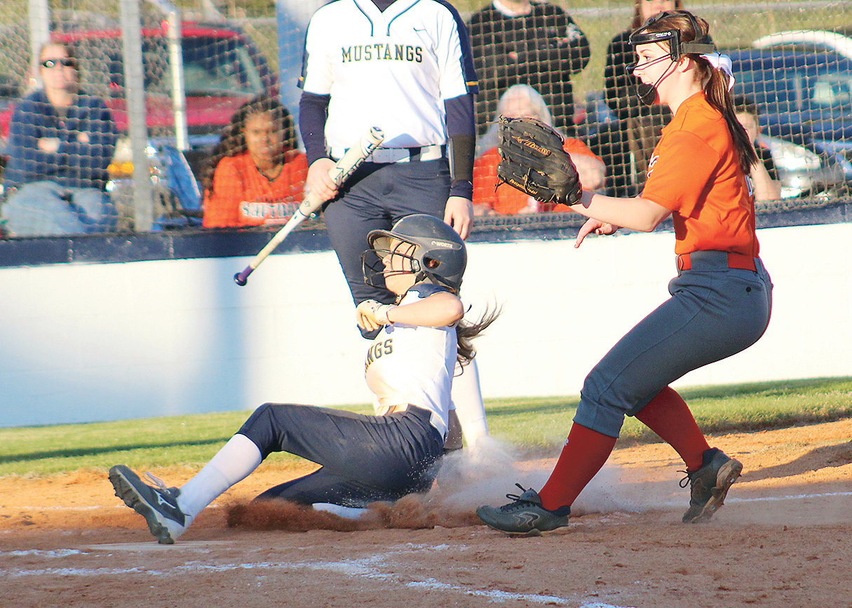 WALKER VALLEY'S Carissa Frost slides across the plate to score on a wild pitch against Kingston, in the bottom of the fourth inning Tuesday, at Walker Valley.
