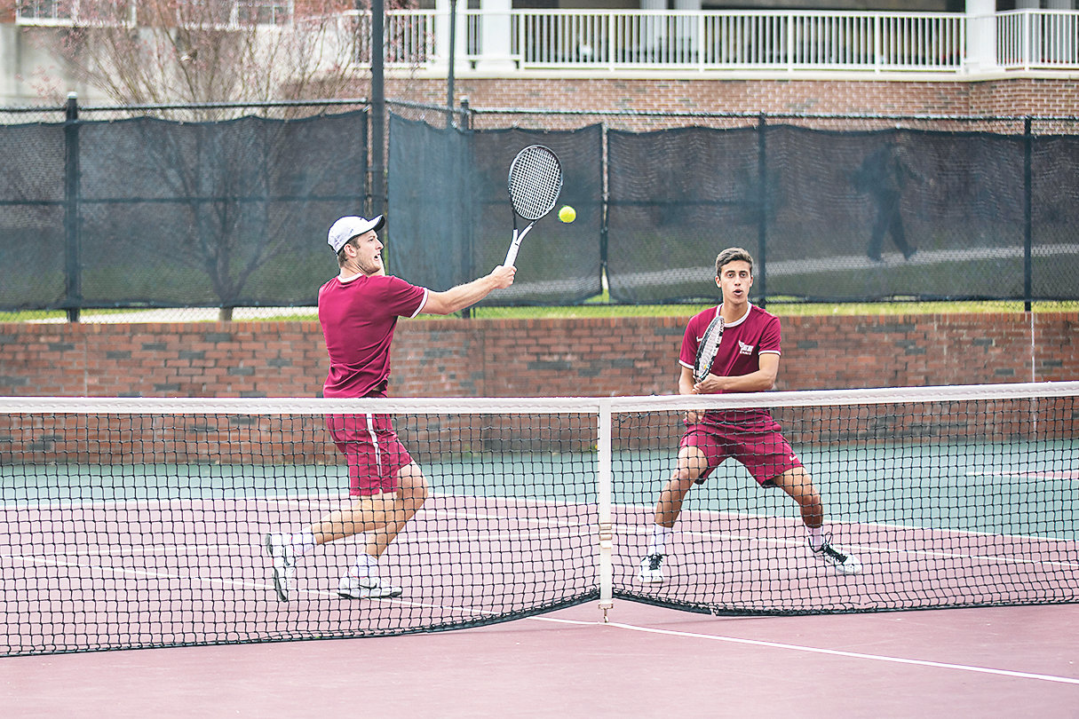 Jake Okines and Bruno Medeiros, from left, battled Shorter at the No. 1 doubles position.