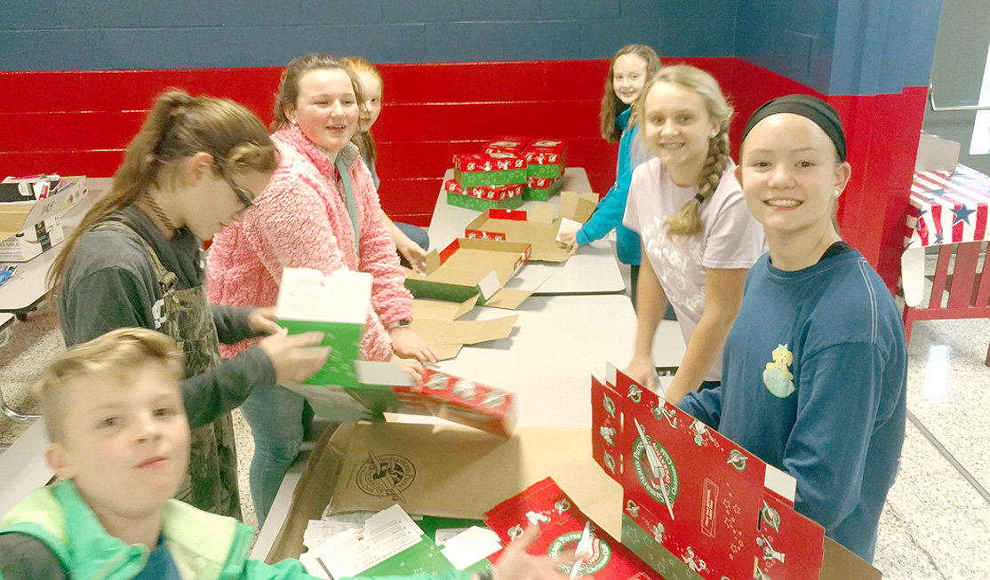 One of the activities of the Polk County 4-Her's includes filling shoeboxes for Operation Christmas Child.