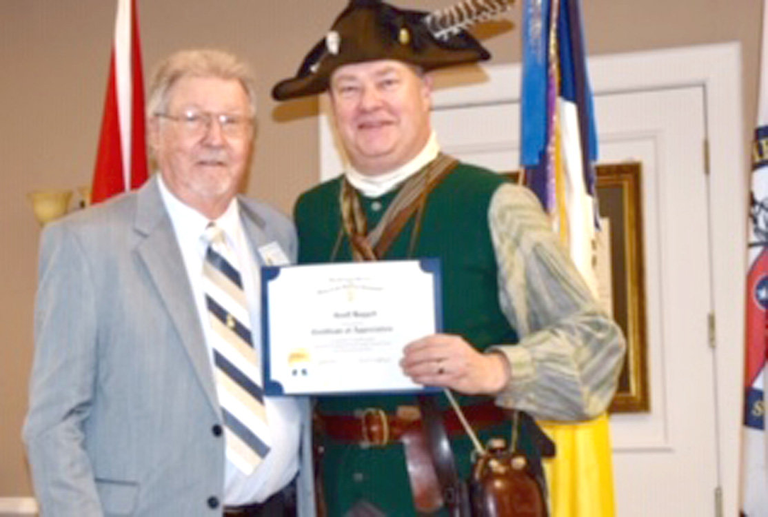 Chapter Second Vice President Jerry Hjellum, left, presents a certificate of appreciation to Geoff Baggett.
