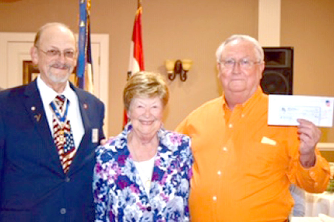 An Alabama SAR member donated a check in memory of the Col. Benjamin Cleveland Chapter founder Stan Evans for local SAR youth programs. Receiving the donation were, from left, Jim McKinney, past chapter president; Maggie Evans, widow of Stan Evans; and Bill Hamilton, chapter treasurer.