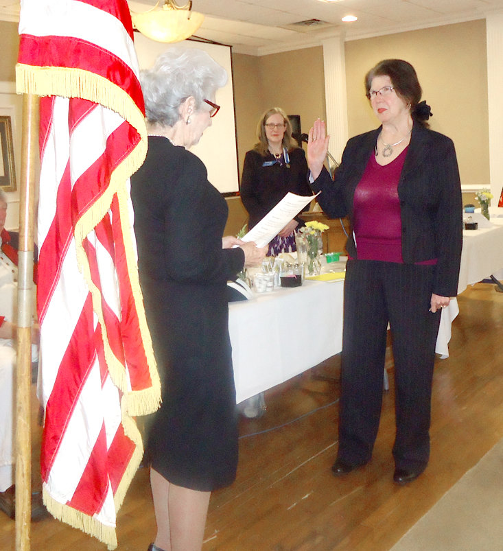 Ocoee Chapter DAR, at left, Chaplain Jane Rumbaugh inducts new member Veronica Fox into the Chapter, as Regent Leigh Ann Boyd observes.