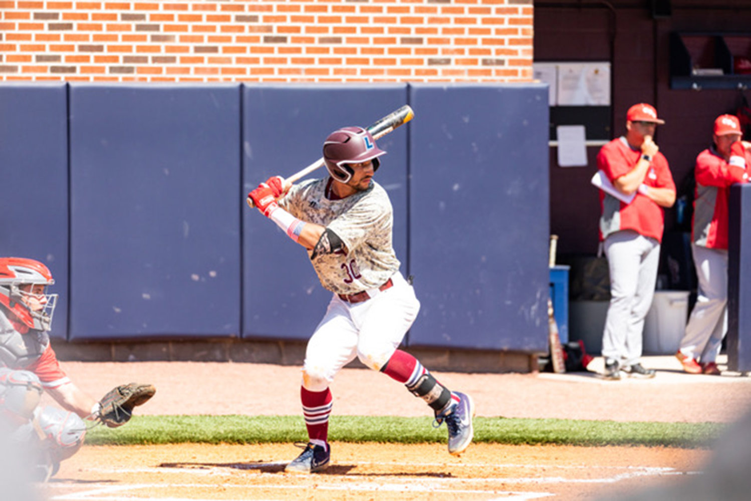 Senior Miguel Pimentel hit a three-run home run in game one and score twice in game two for the Flames.