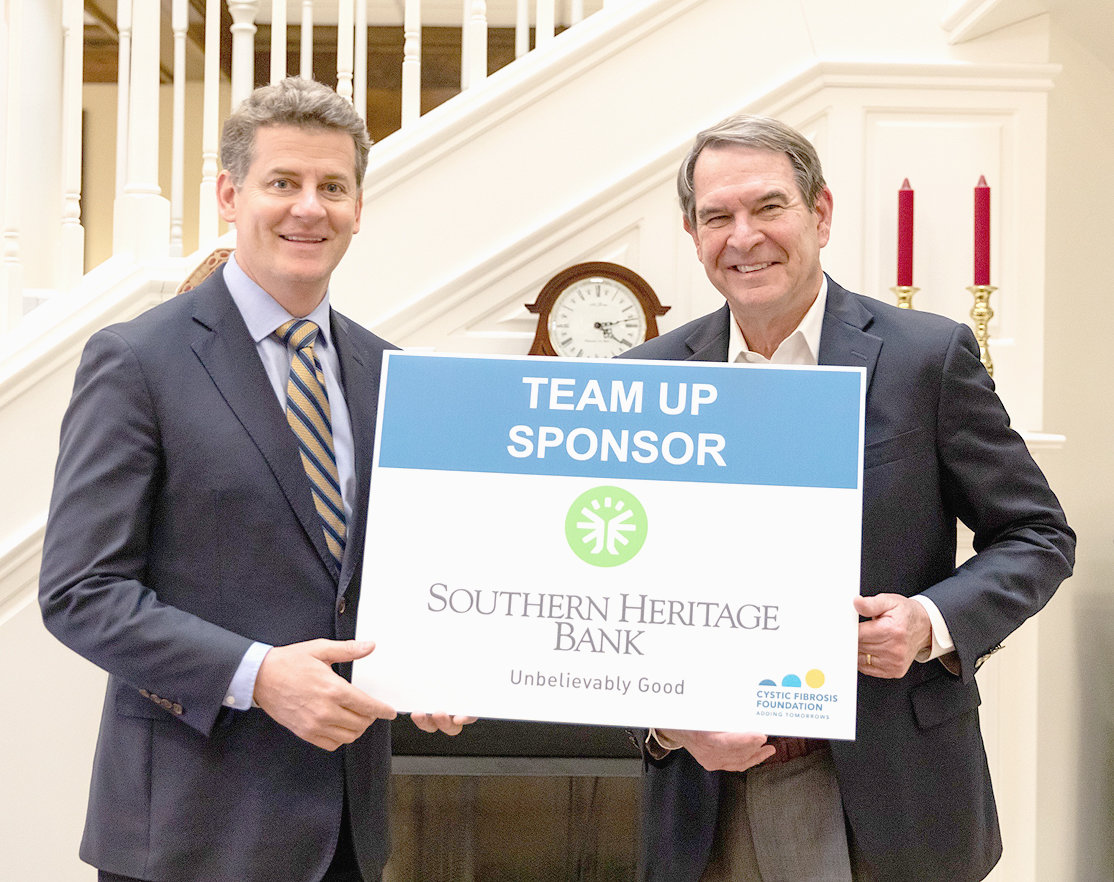 Southern Heritage Bank will serve as the Team Up Sponsor for the 65 Roses 5K race at Great Strides. Hosted by Lee University, the 19th annual Great Strides walk and 17th annual 65 Roses 5K will take place this Saturday at 9 a.m. to raise funds and awareness for the Cystic Fibrosis Foundation. Over 30 community, corporate, school, and CF family teams are signed up to participate, along with hundreds of individual runners and walkers. For more information on this community event or to register, visit www.leeuniversity.edu/cf or call 423-614-8406. From left are Jerome Hammond, CF parent and Lee vice president for university relations, and Lee Stewart, regional president of East Tennessee for Southern Heritage Bank.