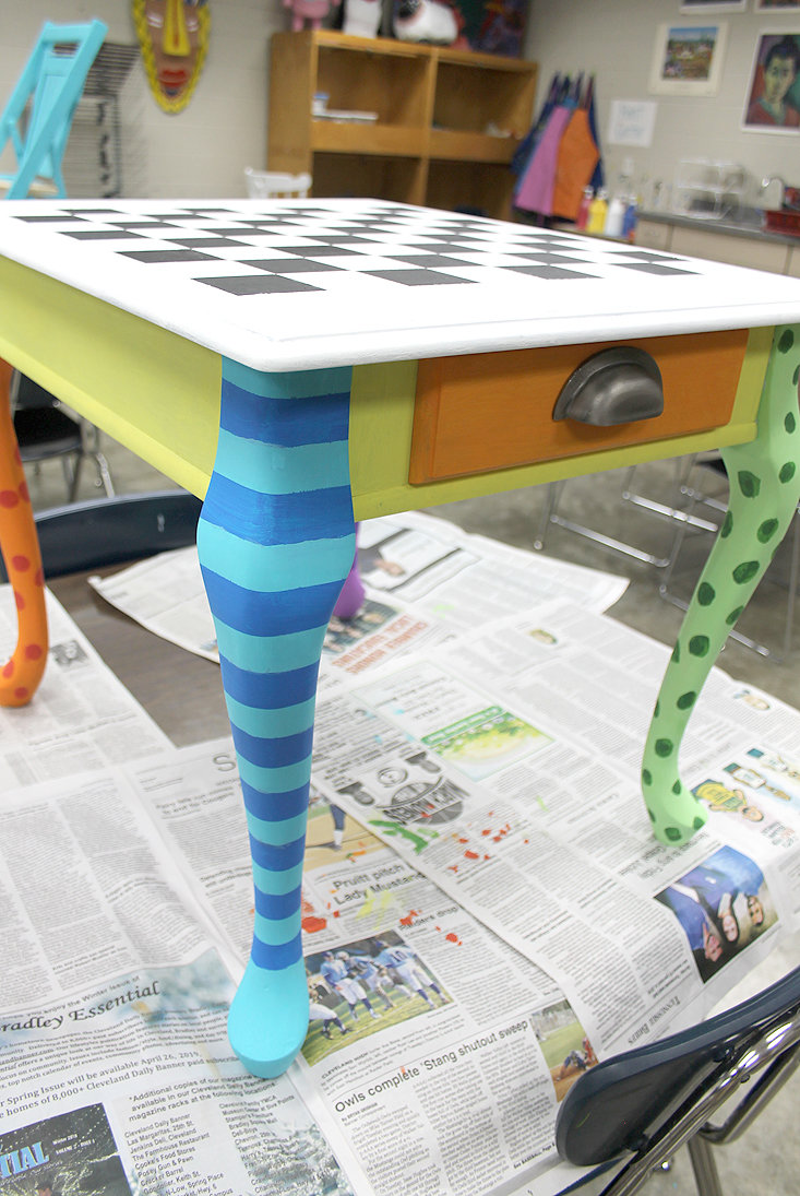 THIS TABLE, once an end table, will fit perfectly into a classroom or child's room.
