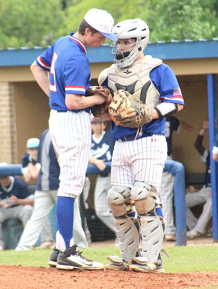 CLEVELAND CATCHER Ryan Lee, right, talks strategy with pitcher Landen Beaty against Coahulla Creek (Ga.), Friday at Raider Field.