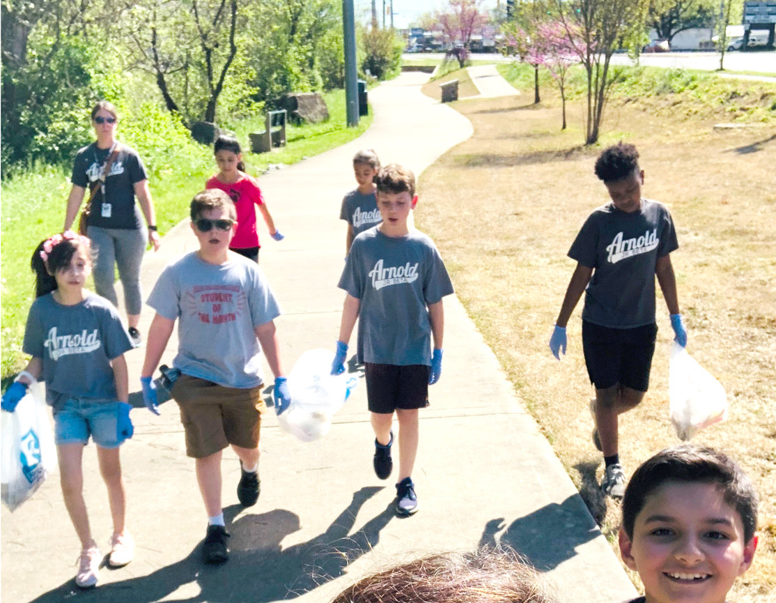 THE BETA CLUB at Arnold Memorial Elementary recently participated in a Greenway Clean-up Day. The sponsors and students walked along the Greenway cleaning up trash. The club has made it an annual event for five years. Junior Beta members include John Washington, Dosen Stum, Skylar Smith, James Avilez, Allyson Jones, Michelle Sosa Pena, Kaylie Mejia and Arly Sanchez. Junior Beta sponsors are  Krissi Martin and Katie Runyan.