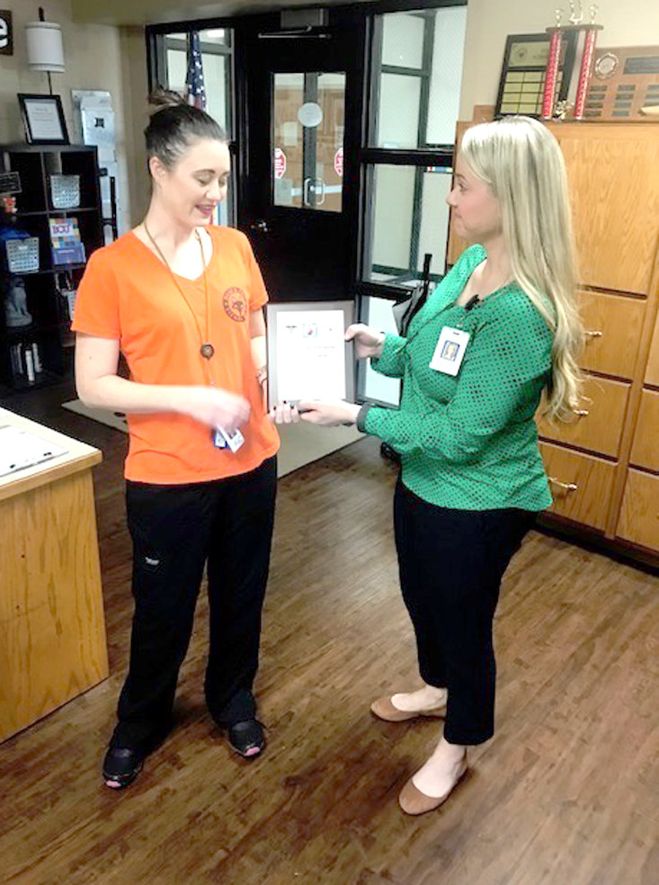 VALERIE LAMON, school nurse at Black Fox Elementary School, left, is presented an award for having conducted 100 telemedicine visits. Presenting the award is Bradley County Schools Nurse Manager Tabitha Payne.
