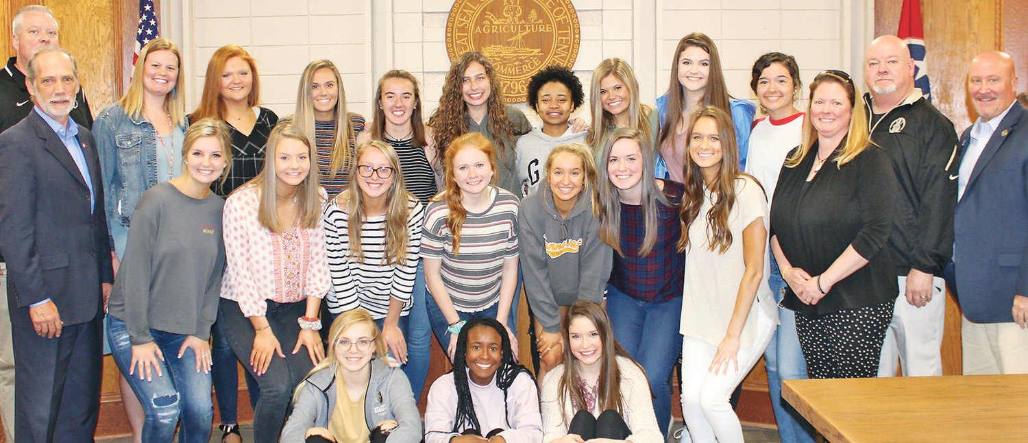 THE BRADLEY CENTRAL High School Bearettes basketball team was honored Monday by the Bradley County Commission. Shown with the team are County Mayor D. Gary Davis, coach Jason Reuter (standing behind Davis) the Bearettes coaching staff and County Commission Chairman Johnny Mull.