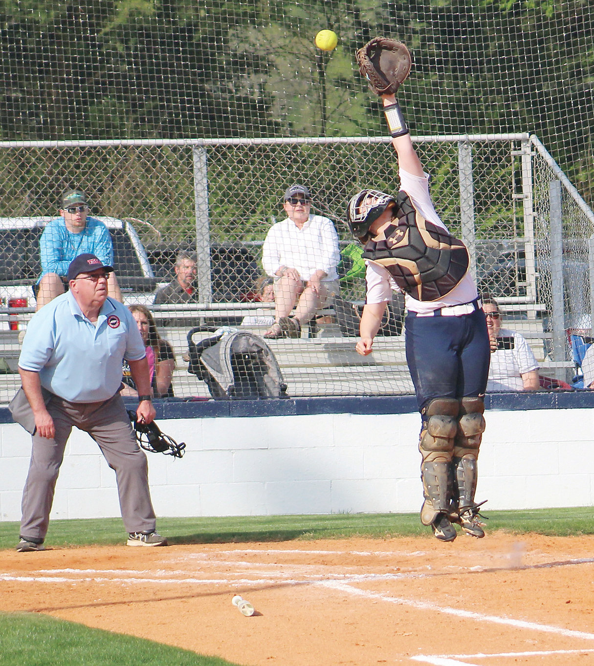 WALKER VALLEY CATCHER Hannah Kate Singleton leaps for a high throw during a District 5-AAA game against McMinn County Thursday, at Walker Valley.