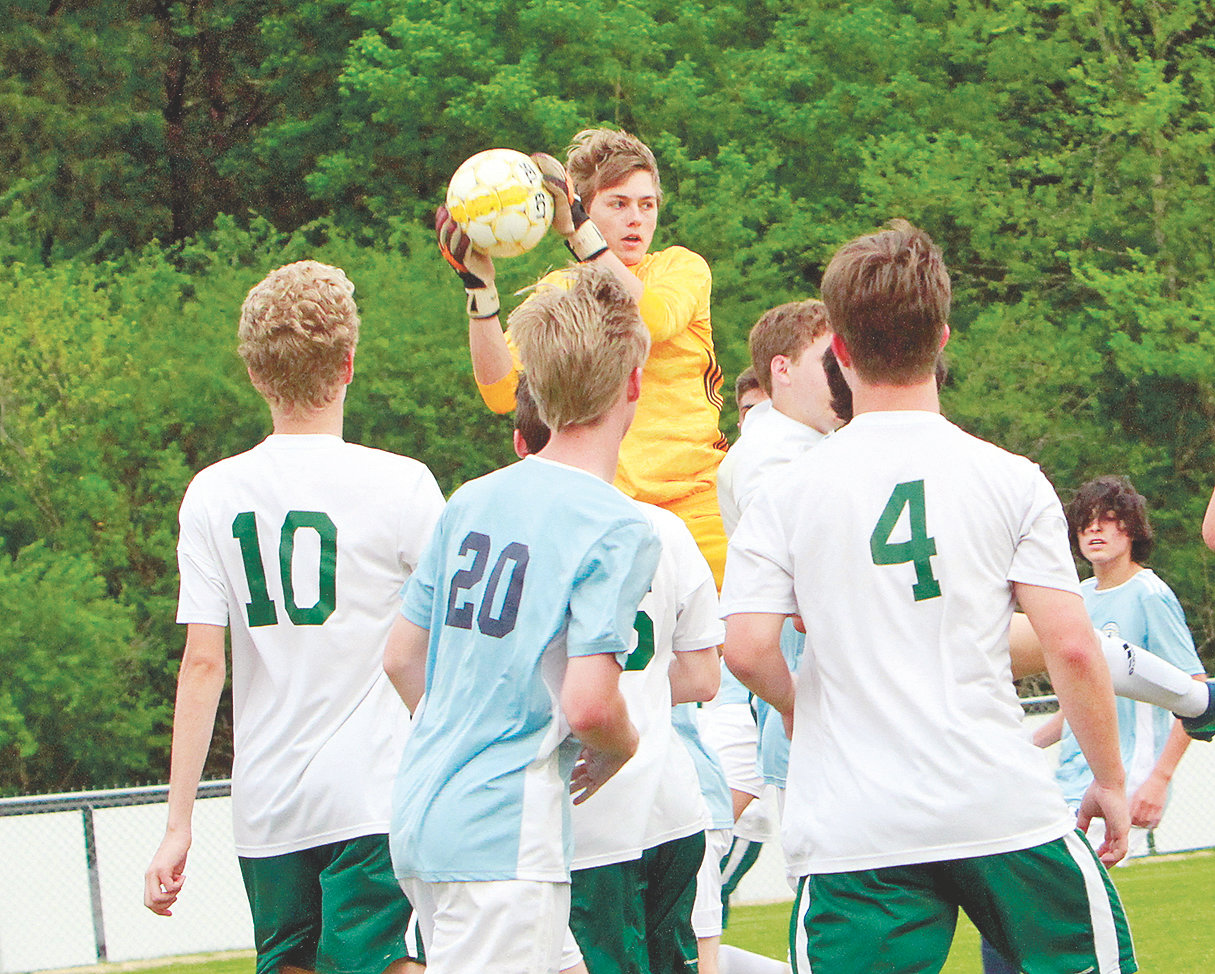 WALKER VALLEY goalkeeper CJ Heifner, center, stops a Silverdale Baptist Academy shot during Thursday's 3-0 Mustang victory on their home pitch.