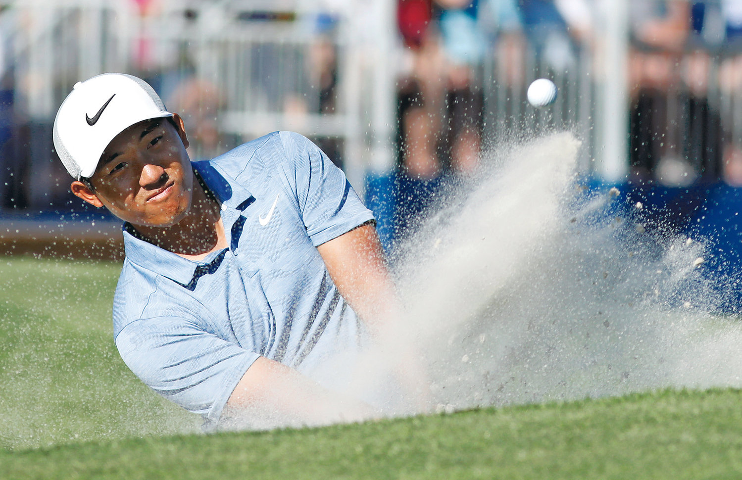C.T. PAN blast out of a bunker on 17th hole during the final round of the RBC Heritage golf tournament at Harbour Town Golf Links on Hilton Head Island, S.C., Sunday. Pan won with a 12-under par for his first PGA victory.