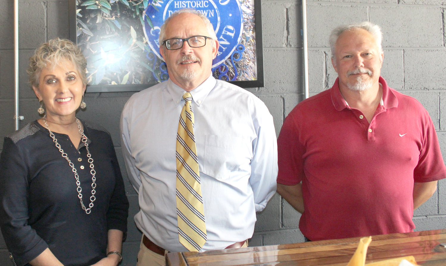 BRADLEY COUNTY Bar Association president Richard Hughes, center, stands with Restoration DUI School director Brenda Thomas and Bradley County Public Defenders Office investigator Ken Ritenour, who spoke during a bar association luncheon held recently at The Press in downtown Cleveland.