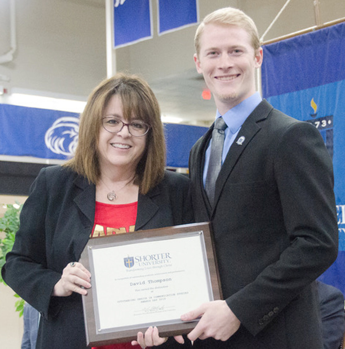 Dr. Kathi Vosevich, associate provost and dean of Shorter's College of Arts and Science, presents the Communication Studies Award to David Thompson of Cleveland. He also took home the Honors Academy Award.
