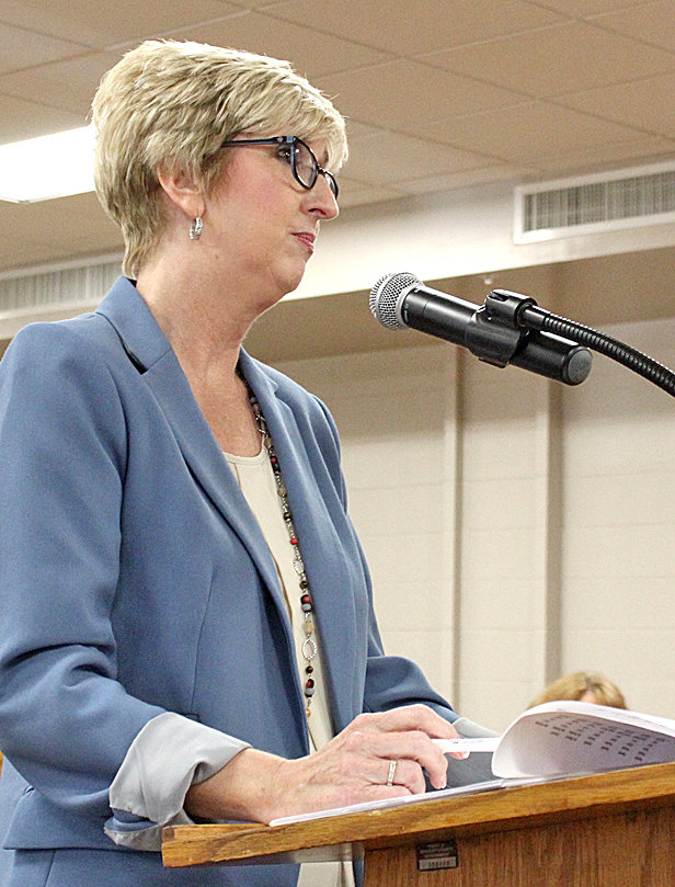 SUSAN WILLCUT, finance director for Bradley County Schools, reviews the the school system's 2019-20 budget request during Monday's Bradley County Commission work session.