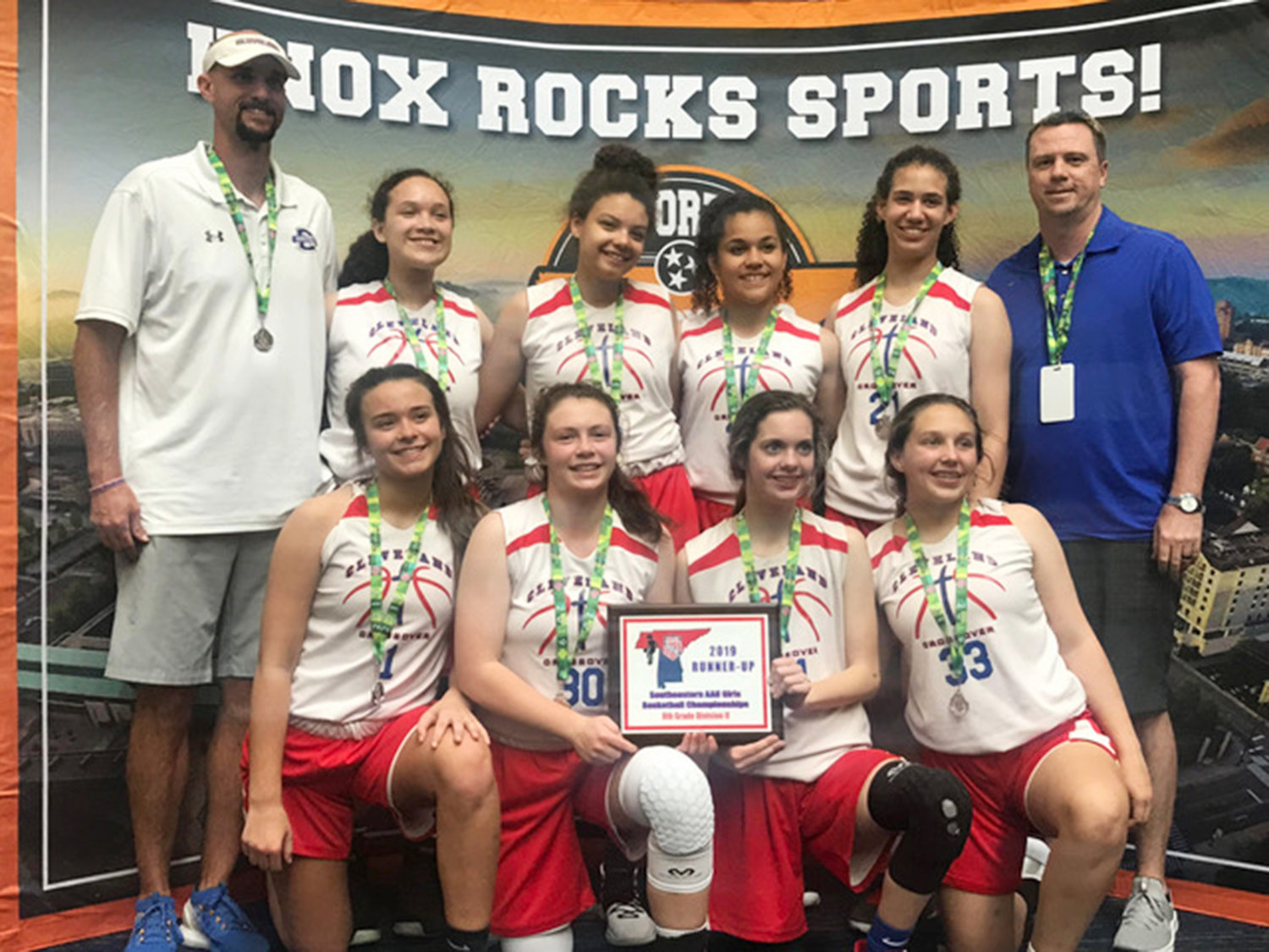 THE CLEVELAND CROSSOVER eighth-grade girls basketball team was runner-up in the 2019 Southeastern District AAU Girls Basketball Division II Championship last weekend in Knoxville, going 3-1 in bracket play. Front row, from left, Milah Williams, Dani Reeves, Paige Moody and Lily Brady. Back row, from left, Cleveland High School girls head coach Tony Williams, Neveah Hjulberg, Alayna Johnson, Emery Arnwine, Jaydin Lee and assistant coach Clay Moody. Not pictured is Tyria Tanner.