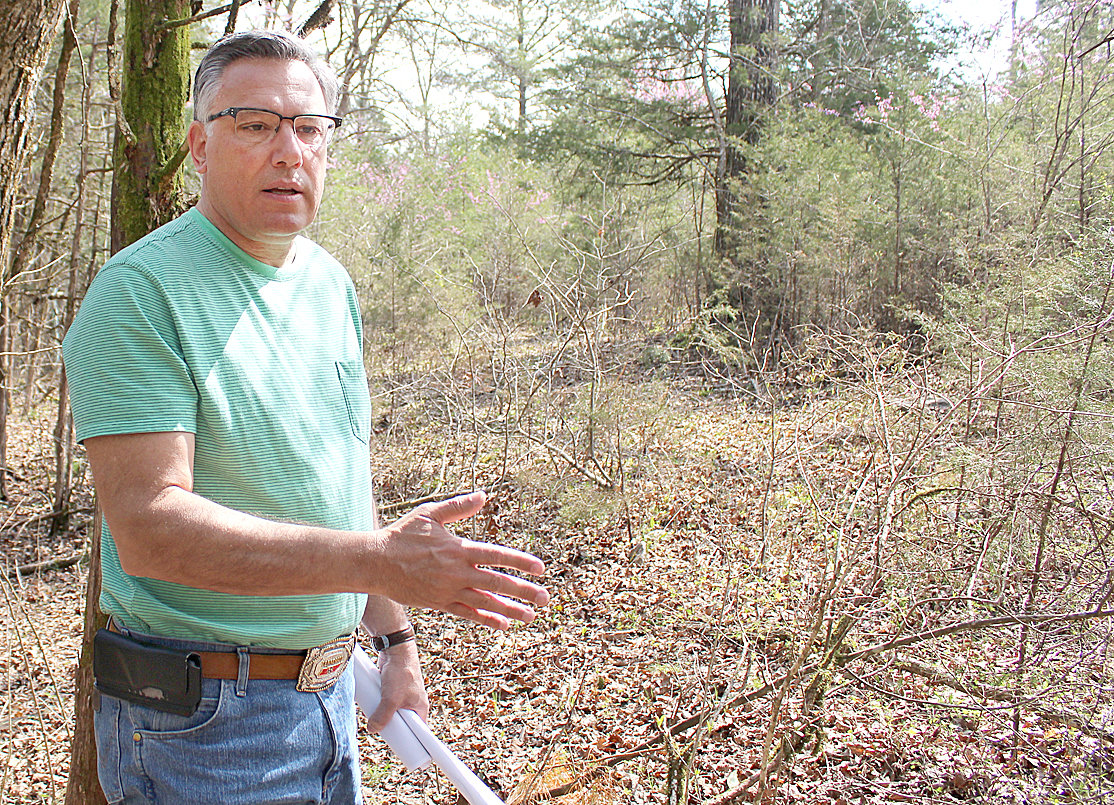 GREG A. VITAL pauses during a walk around his Meigs County property last month. Vital is currently pursuing legal action regarding TVA's use of eminent domain to gain access to his land for a planned transmission line project.