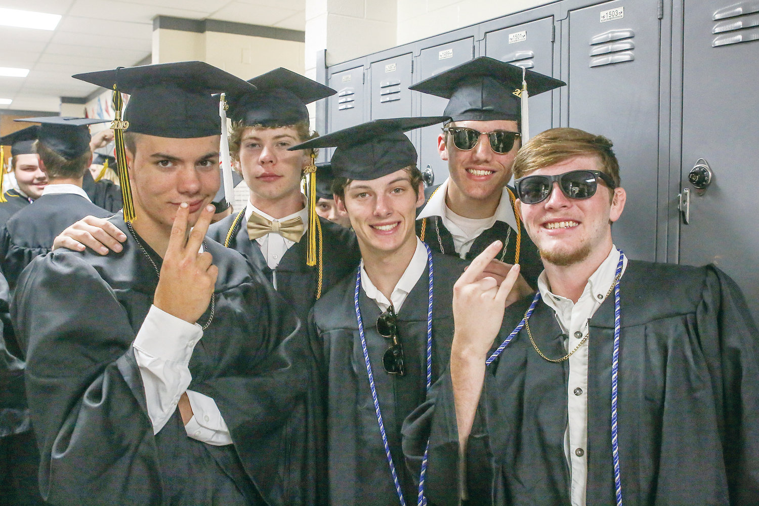 AN EXCITED CREW OF Jacob Cantrell, Colin Cartwright, Gage Brakebill, Fisher Creaseman and Skyler Bradley pose for a quick pic just before graduation.