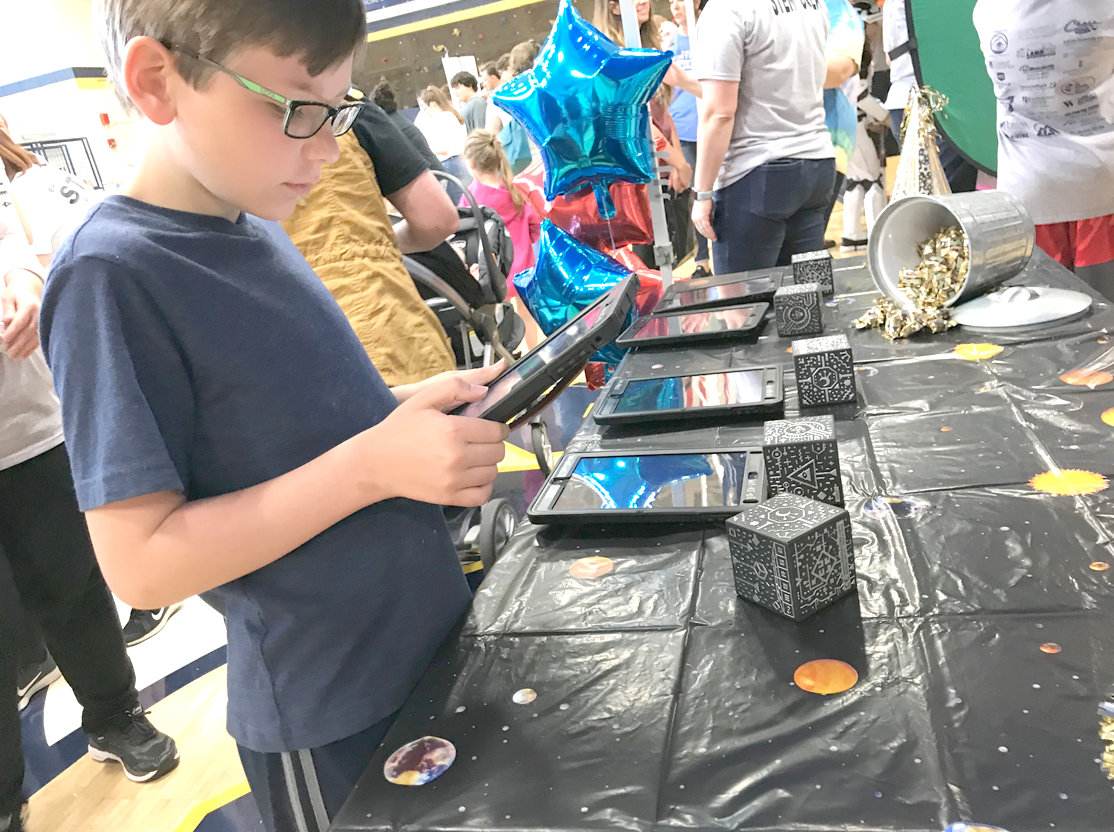 CHECKING OUT the technology, a student participates in an activity at Bradley County Schools' STEM on the Greenway event.
