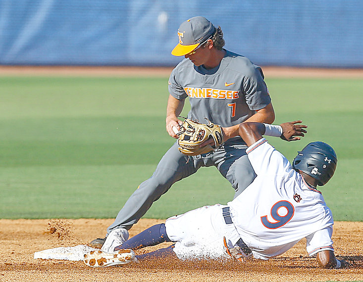 TENNESSEE SECOND BASEMAN Jake Rucker (7) gets the force out on Auburn's Ryan Bliss (9) as he slides into second in the first inning at the Southeastern Conference tournament Tuesday, in Birmingham, Ala.