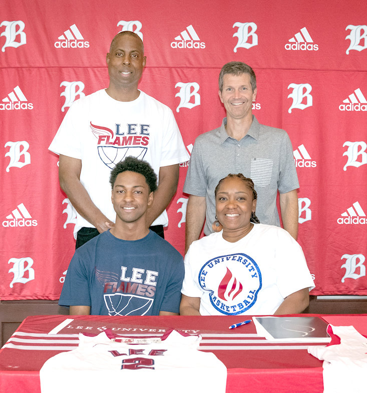 BAYLOR SCHOOL SENIOR Beyuan Hendricks has signed to play basketball at Lee University. Seated, from left, Beyuan Hendricks; Nakia Hendricks, mother. Standing, from left, Bethel Hendricks, father; and Baylor Coach Mark Price.