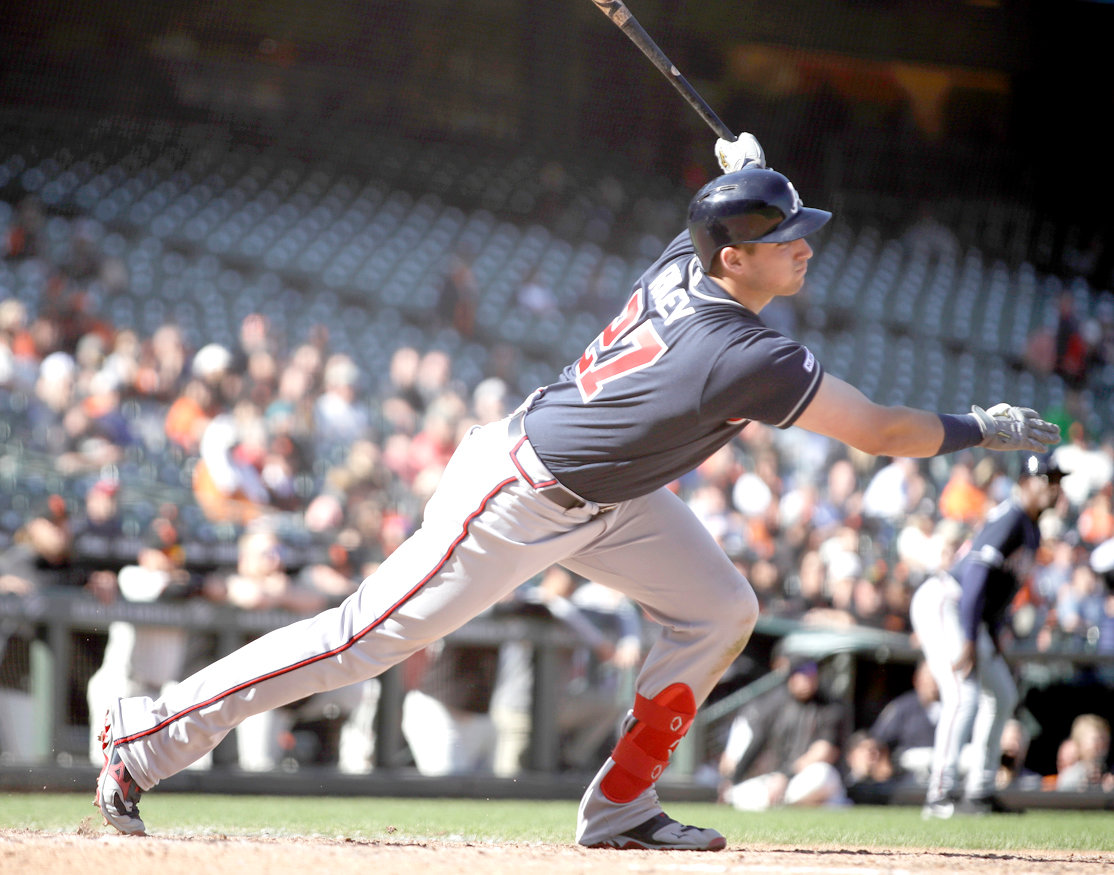 ATLANTA BRAVES' Austin Riley follows through on an RBI single off San Francisco Giants' Reyes Moronta in the 13th inning inning Thursday, in San Francisco.
