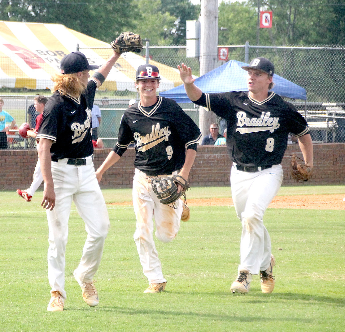 BRADLEY CENTRAL seniors Ryan Giovengo (1) and Dylan Standifer (8), plus sophomore Ashton Simmons (9) celebrate after Stanbdifer pulled off a double play to end a sixth-inning scoring threat by Riverdale in Thursday's 4-3 Bear victory in the TSSAA Semifinal Game in Murfreesboro.