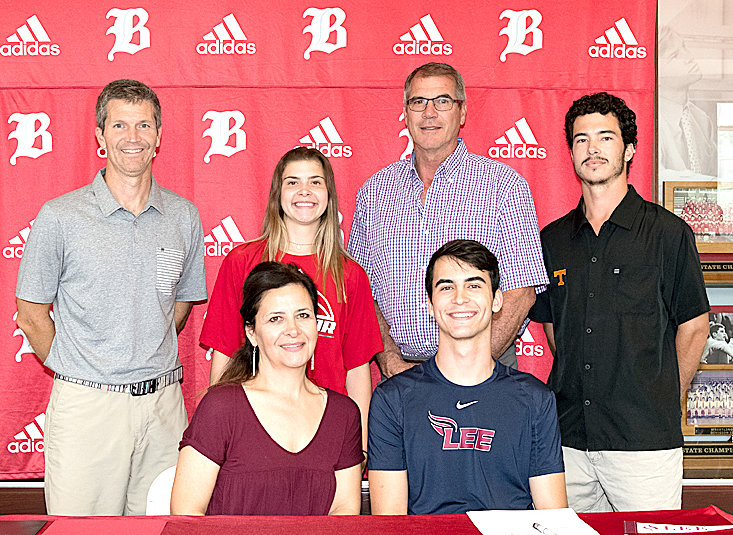 BAYLOR SCHOOL SENIOR Lorenzo White has signed to play basketball for Lee University. Seated, from left, his mother, Elena White, mother; and Lorenzo White. Standing, from left, Baylor Coach Mark Price; Isabella White, sister; Chris White, father; and Alex White, brother.
