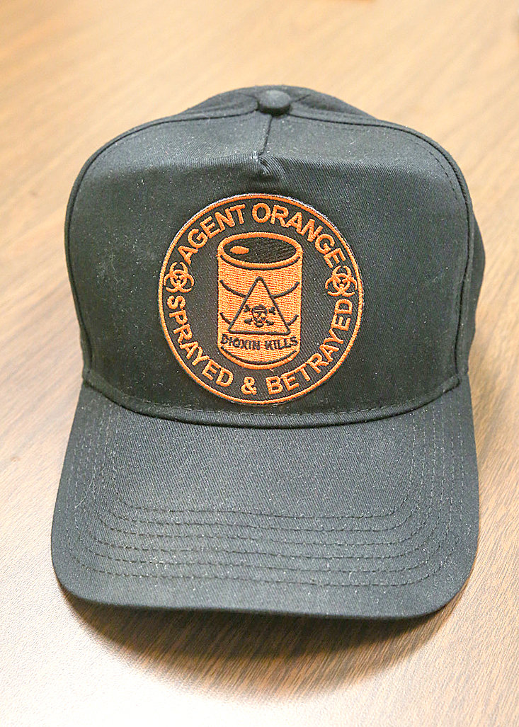 "A HAT belonging to Roger Jones, who is a veteran of the Vietnam War, is emblazoned with ""Agent Orange: Sprayed & Betrayed."" Jones, who served in Thailand during the Vietnam War, was exposed to Agent Orange while serving with the United States Air Force from 1969 to 1970."