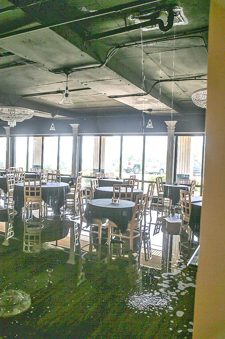 WATER drips onto the dining room floor at King's Table Restaurant, where a guest in a hotel room located above the eatery allegedly started a fire. The restaurant is located at the Mountain View Inn, formerly the Holiday Inn. A restaurant spokesman said the eatery will remain closed for the foreseeable future, but does plan to reopen.