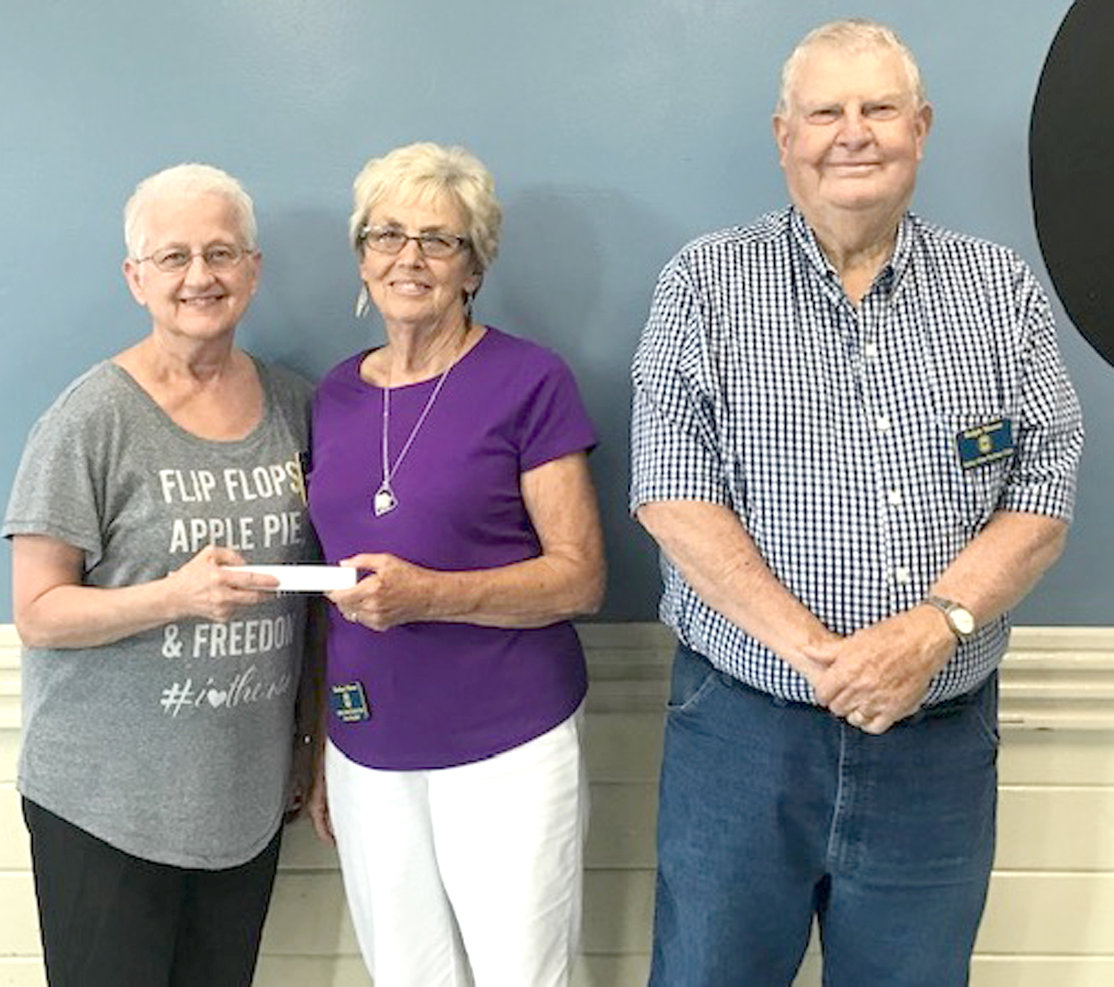 Joann Truelove, Cherokee Ruritan District governor, presents Barbara Mason with the Outstanding President Award for the Valley View Ruritan  Club. From left are Truelove; Mason; and Ralph Mason, Valley View Ruritan president.