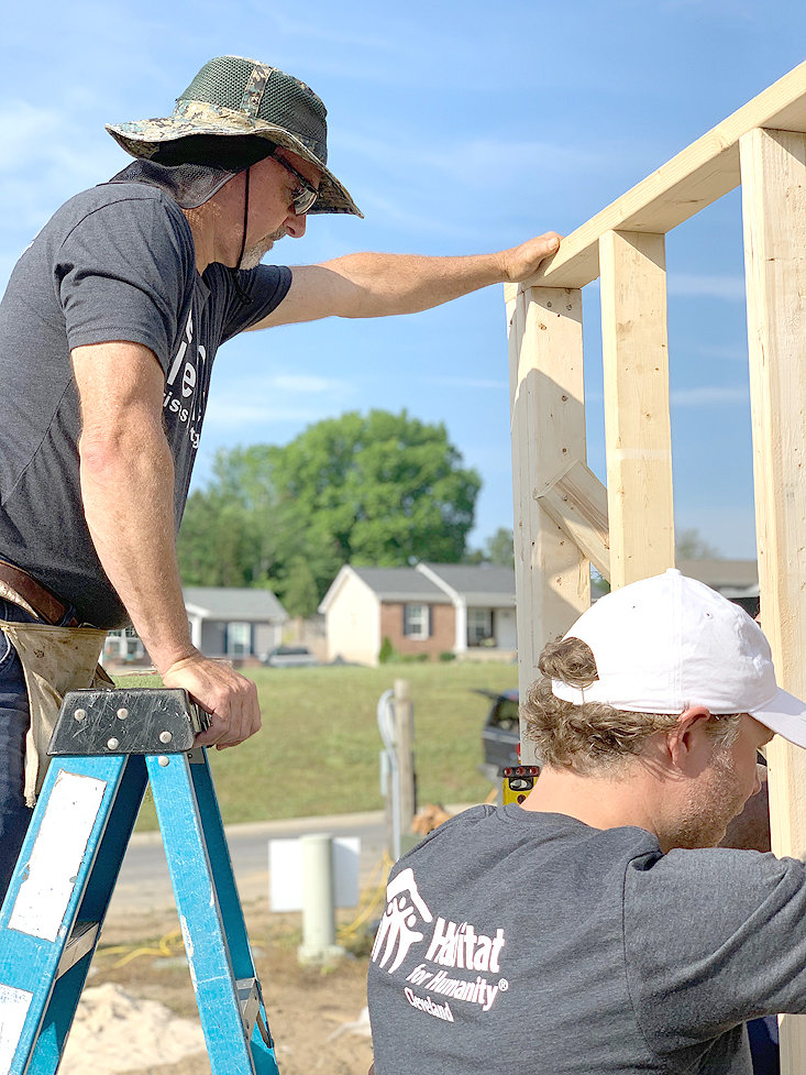 STATE SEN. MIKE BELL, left, helps frame the future home of Victor Headrick at Thursday's Habitat Leaders' Build.