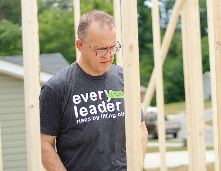 DR. MIKE HAYES with Lee University was one of at least 20 community leaders to come out and work on the future home of Victor Headrick and his son, Ethan, with Habitat of Cleveland.