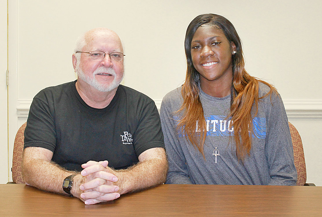 WHILE IN town for a short visit, former Bradley Central star Rhyne Howard, right, took time to stop by the Banner office for an interview with Gary Ownbey.