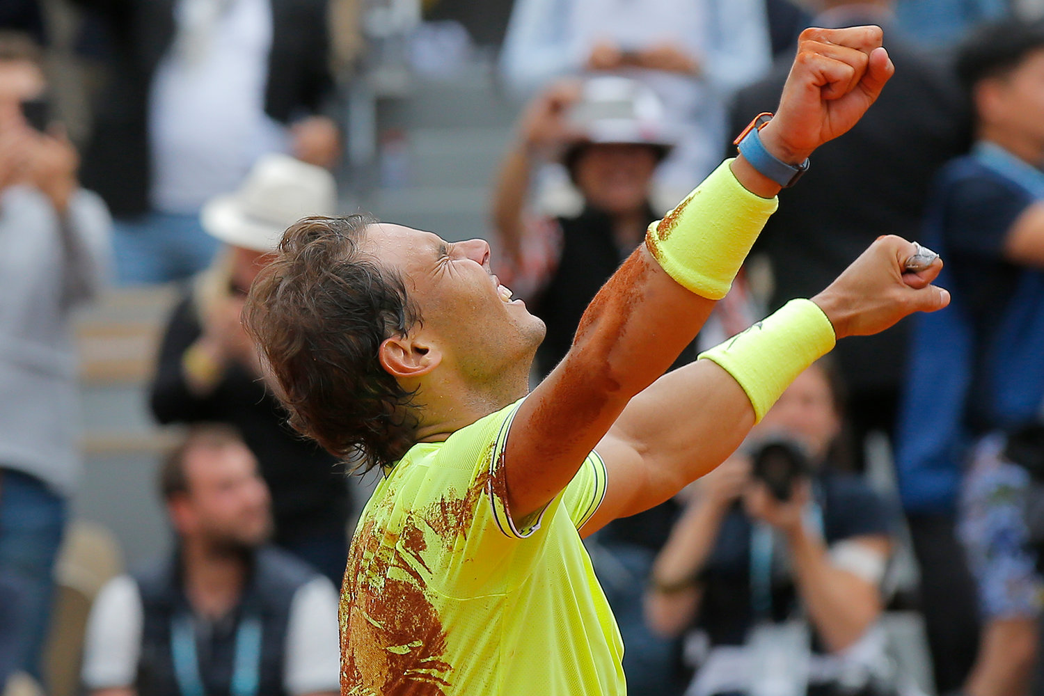 Spain's Rafael Nadal celebrates his record 12th French Open title after winning his men's final match against Austria's Dominic Thiem in four sets, 6-3, 5-7, 6-1, 6-1, at the Roland Garros stadium in Paris, Sunday.