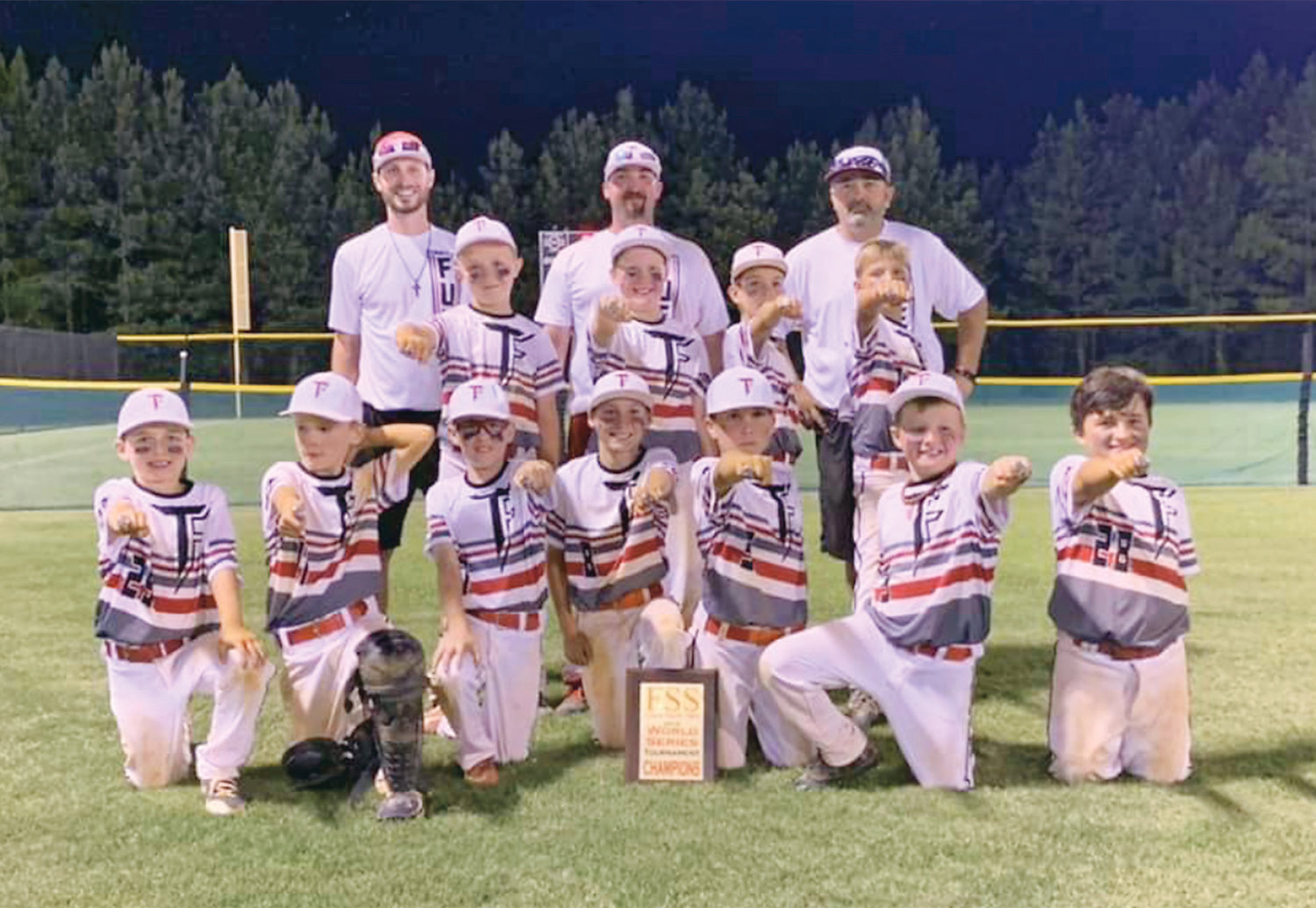 THE TENNESSEE FUEL 9-under baseball team won the FSS Future Sports Stars World Series at Heritage Park, in Dalton, Ga., recently. Front row, from left, Jax Knight, Jackson Jenkins, Landon Jenkins, Jackson Gonzalez, Connor Burns, Camden Beaty, and Treyton Pickett. Middle row, from left, Bryson Lawson, Kaleb Young, and Logan Hibbens. Back row, from left, coaches Ricky Webb , Gerald Brewer, and Joey Young.