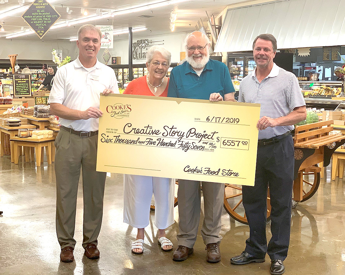 Creative Story Project celebrated the receipt of funds collected from customers of Cooke's Food Store and its two nearby Fresh 'n Low stores. The donations will enable Pete and Joyce Vanderpool to present multiple programs using the power of creative story in area care facilities benefitting Alzheimer's and dementia residents . From left are Keith Scott, Cooke's Food Stores; Joyce and Pete Vanderpool, and Jim Phiropoulos, Cooke's Food Stores.