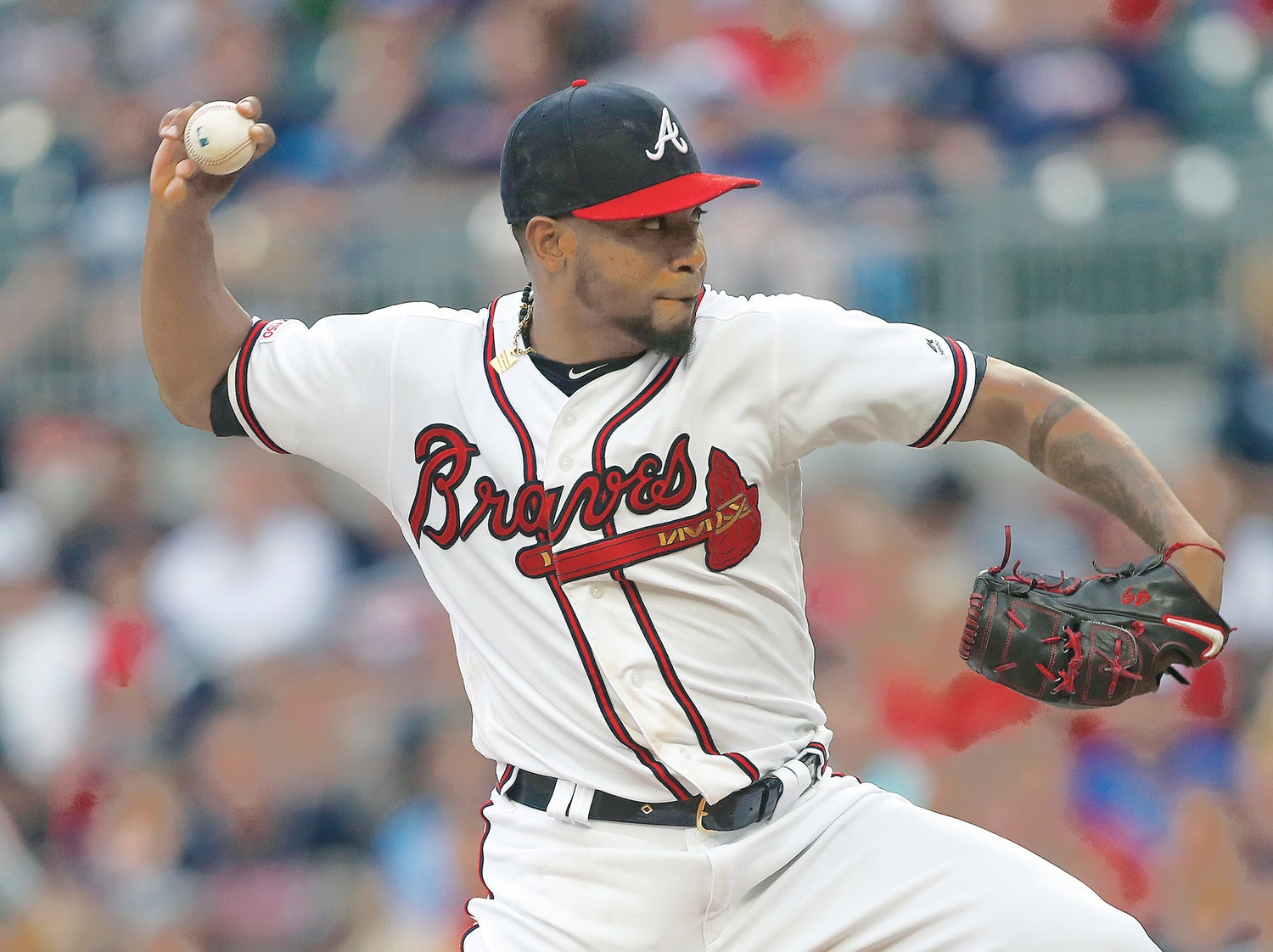 ATLANTA BRAVES starting pitcher Julio Teheran (49) works against the New York Mets in the first inning Tuesday, in Atlanta.