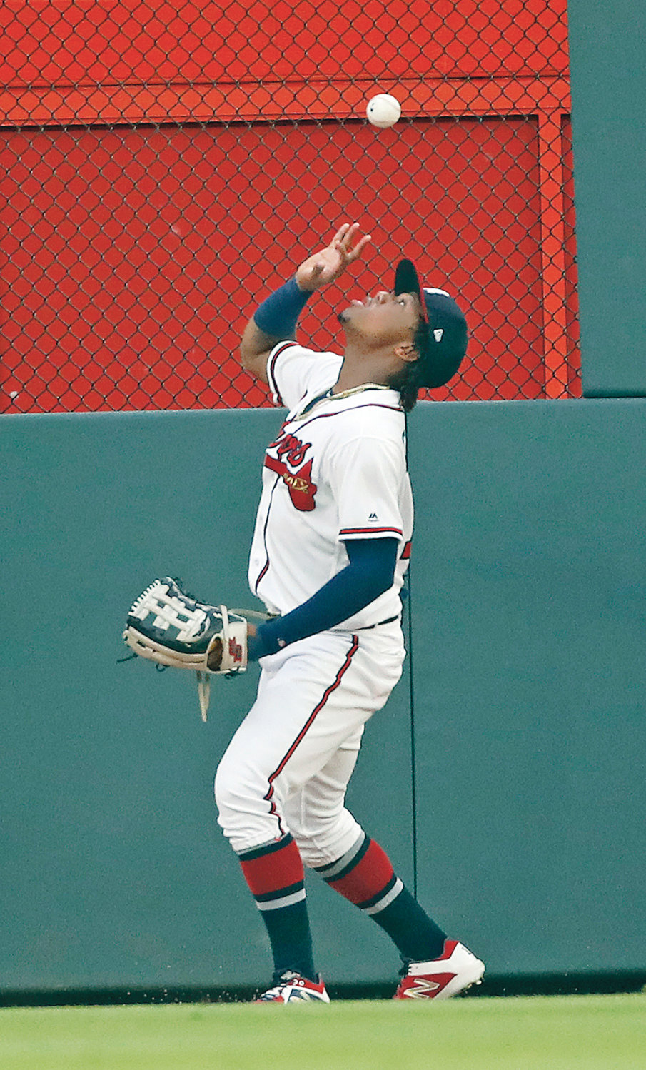 ATLANTA BRAVES center fielder Ronald Acuna Jr. (13) bare hands a ball hit for double by New York Mets' Jeff McNeil in the third inning Tuesday, in Atlanta.