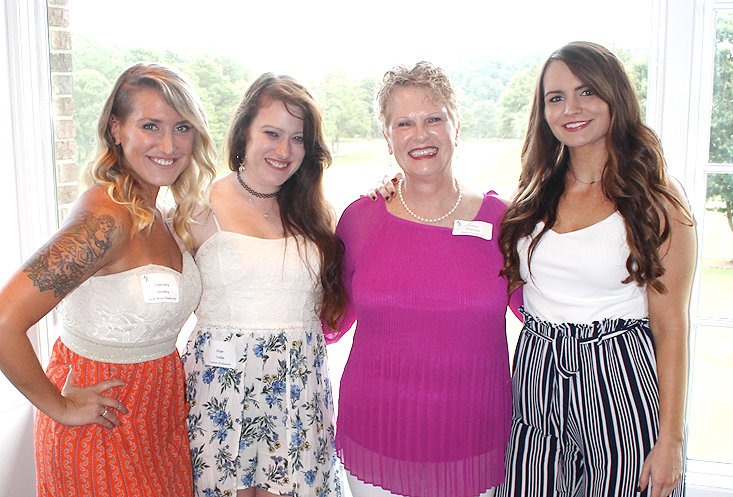 JANICE NEYMAN, executive director of the Museum Center at 5ive Points, poses with her  staff at Thursday evening's Ocoee Society event. From left are Courtney Shirkey, Hope Vollm, Janice Neyman and Kayla Adams.