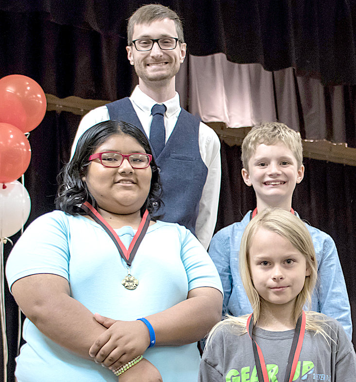 THE ART AWARD for fifth-graders at George R. Stuart Elementary was given to students Esmeralda Gallegos, Kieran Gibson and Ben Coulston. They are joined by teacher Jonathan Dockery.
