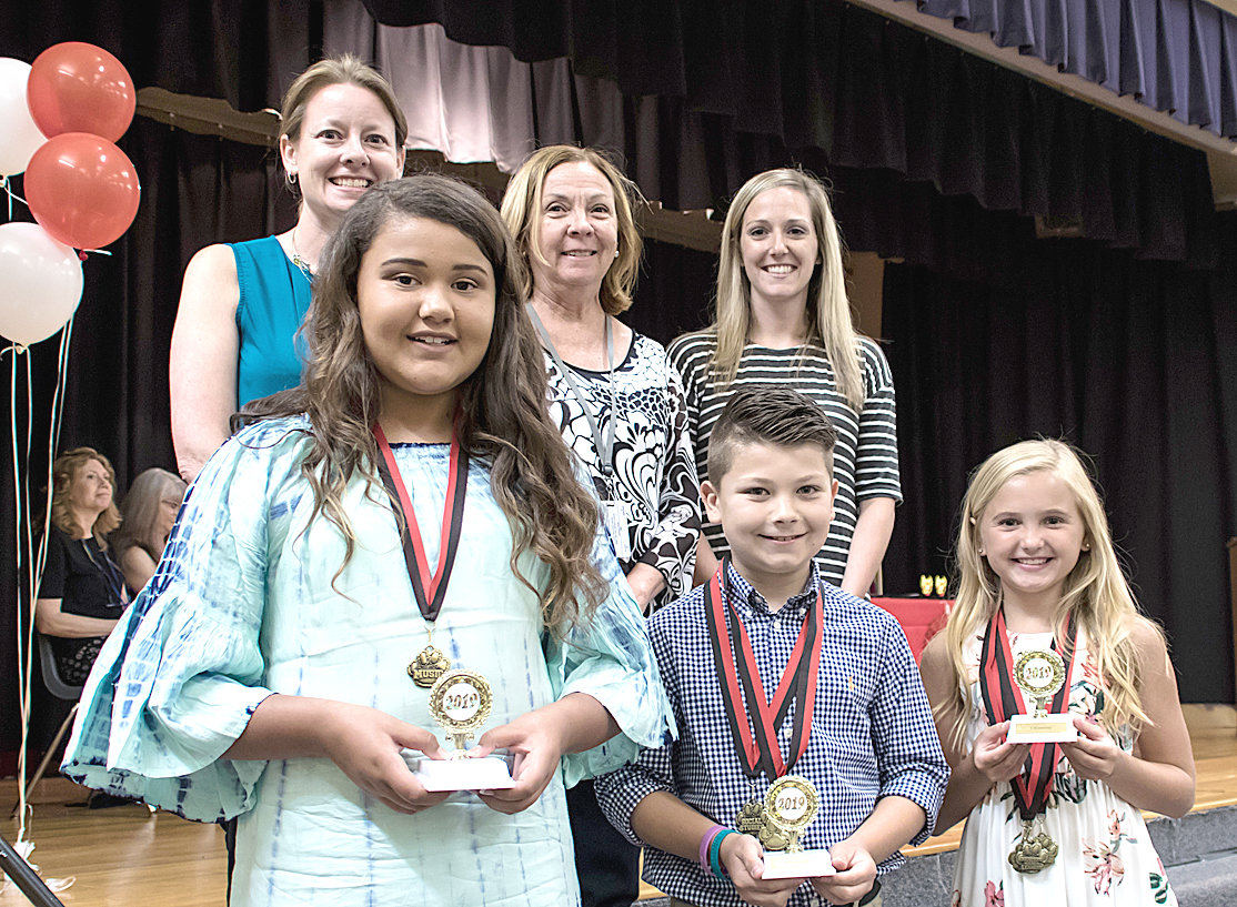 CITZENSHIP AWARDS were presented to three fifth-graders at George R. Stuart Elementary. From left are Christina Melton, Shae-Lee Thomas, Nancy Cooke, Carter Haun,  Megan Martin and Macy Butler.