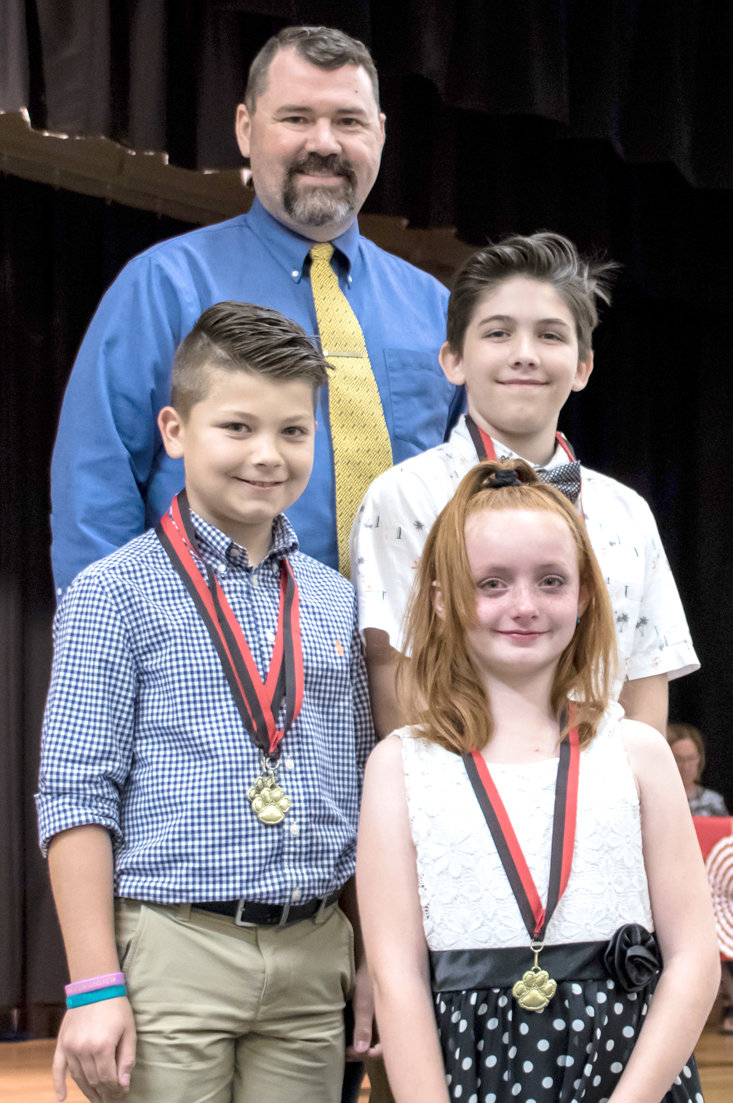 COMPUTER AWARDS were presented to three fifth-graders at George R. Stuart Elementary. From left are  Chris Reid, Carter Haun, Timothe Luithle, and Katie Kalaschenkow.